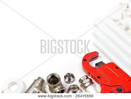 Polypropylene pipes  fittings and cutter on white background