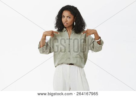 Stylish African-american Woman Pointing At Herself With Unsure Expression Being Confused Friend Blam