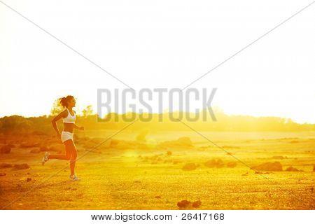 A woman running down a path at the beach