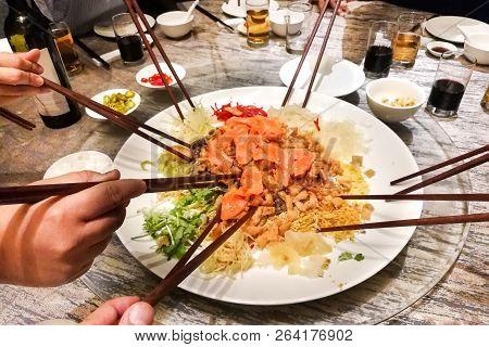 People Tossing Yee Sang Or Yusheng During Chinese New Year