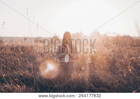 Girl Closed Her Eyes, Praying Outdoors, Hands Folded In Prayer Concept For Faith, Spirituality And R