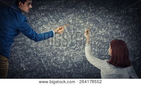 Man And Woman Sharing Thoughts Together Solve Difficult Tasks On Blackboard. Idea Exchange, Hard Mat
