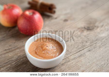 Apple Sauce. Fresh Homemade Applesauce (apple Puree, Mousse, Sauce) With Cinnamon And Apples On Wood