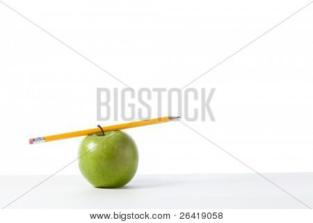 A Green Apple isolated on write with a pencil