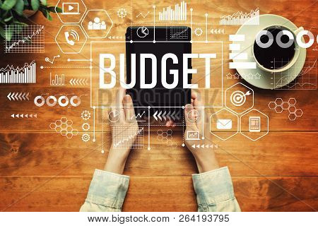 Budget With A Person Holding A Tablet Computer