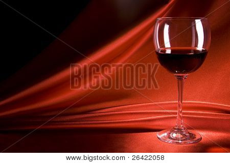 wineglass on fabric background