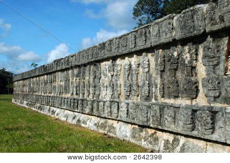 Wall Of Skulls Among Mayan Ruins