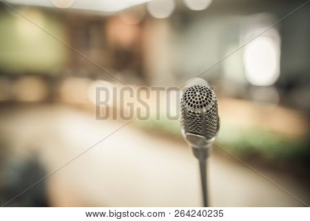 Front Microphone On Abstract Conference Hall Prepare For Speaker On Stage In Seminar Room, Business