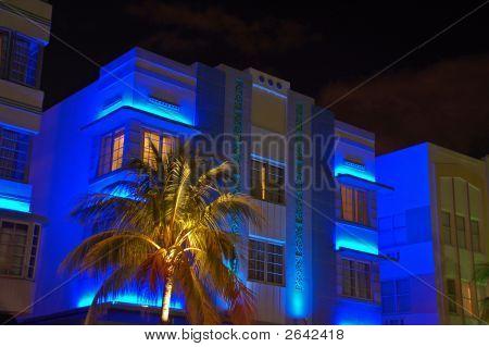 Night-Time Blue Art Deco Hotel In South Beach