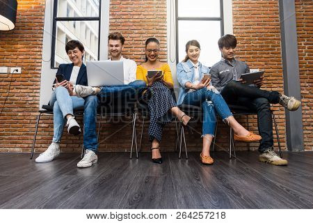 Group Of Asian And Multiethnic Business People With Casual Suit Using The Technology Mobile, Tablet,