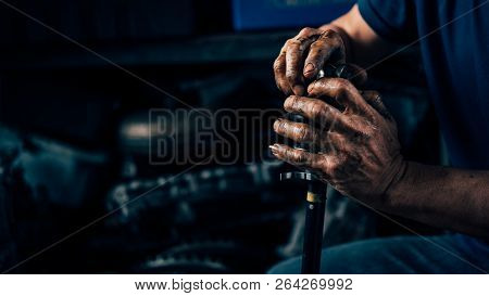 Car mechanic or serviceman disassembly and checking a car alloy chrome wheel for fix and repair suspension problem at car garage or repair shop poster