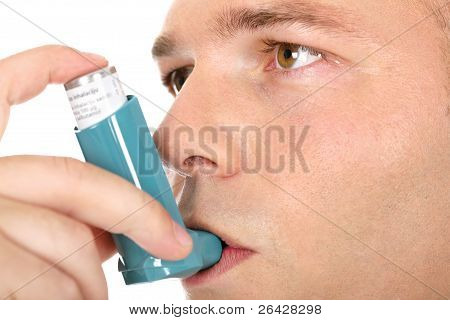 Close Up Look Of A Man With Pump In His Mouth, Against Asthma