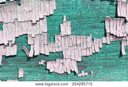 Old Wooden Background With Remains Of Pieces Of Scraps Of Old Paint On Wood. Texture Of An Old Tree,