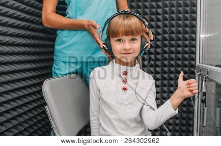 Little Girl During The Hearing Exam In The Audiologists Office