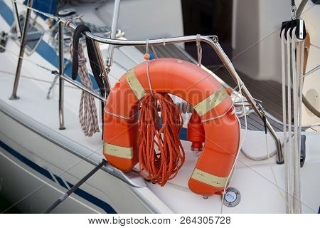 Close Up Of Lifeguard Buoy Tied To Railing Of Yacht