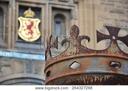 Crown In Front Of Gate To Edinburgh Castle, Royal Stuart Coat Of Arms In Background, Scotland, Unite