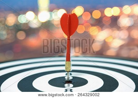 Red dart target arrow hitting on bullseye over blurred bokeh light background, Metaphor to accuracy in business success concept, Marketing conceptual poster
