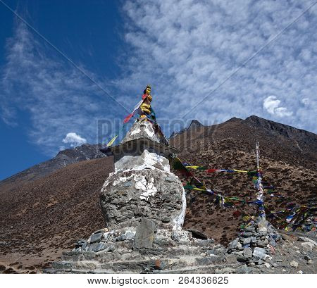 Ancient Buddhist Stupa With Prayer Flags Above Dingboche Village On The Way To Everest Base Camp, Sa