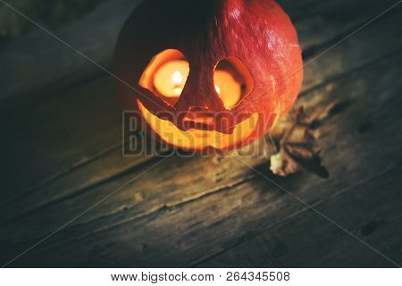 Burning Halloween Pumpkin Lantern Head Jack With Leaves On Wooden Background Mistery