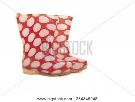 Red And White Polka Dotted Rainboots For Kids Isolated On A White Background