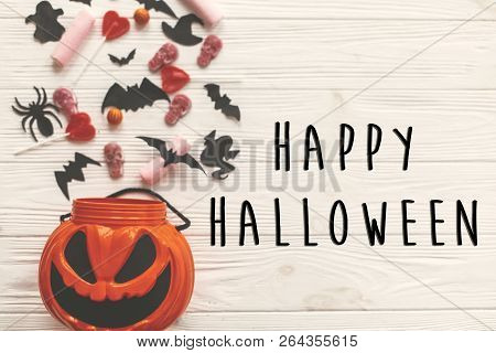 Happy Halloween Text Sign, Flat Lay. Jack O Lantern Bucket With Holiday Candy, Bats,spiders, Skulls