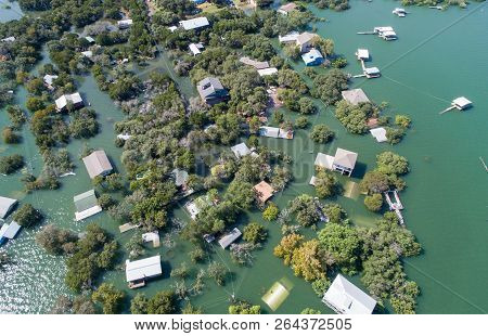 High Above Entire Community Under Water , Focused On A Group Of Houses Half Way Under Water Aerial D