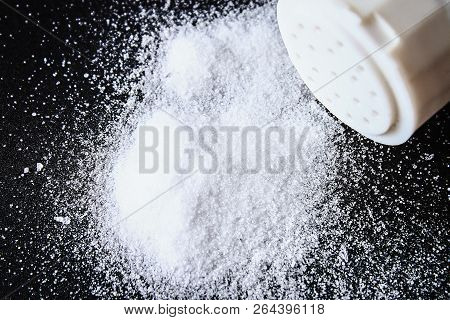 Slides Of Small Crystals Of Salt Are Scattered On A Black Table.
