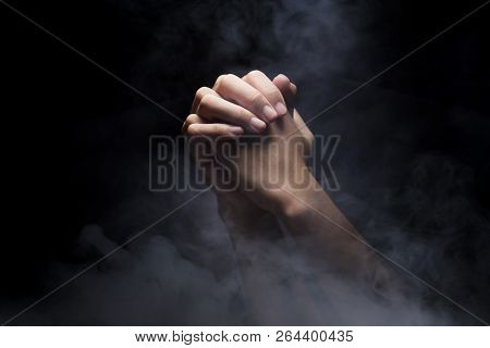 Praying Hands Over Dark Background. Christian Pray