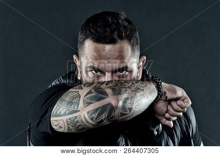 Tattooed Elbow Hide Male Face Dark Background. Visual Culture Concept. Tattoo Can Function As Sign O