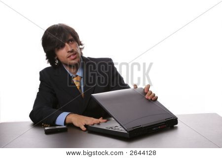 Young Bussiness Man Opening His Laptop At The Beggining Of The Day