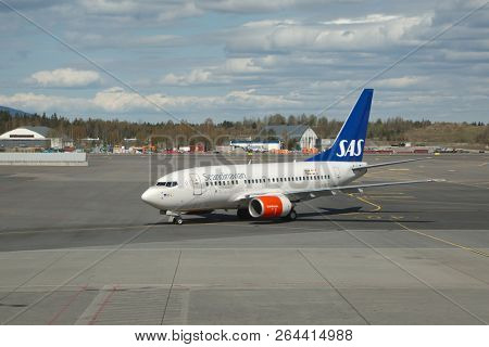OSLO, NORWAY - MAY 3, 2015: Airliner of SAS Scandinavian Airlines taxiing at Oslo Gardermoen airport, the main international airport of Oslo