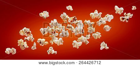 Popcorn Isolated On Red Background. Falling Or Flying Popcorn. Close-up