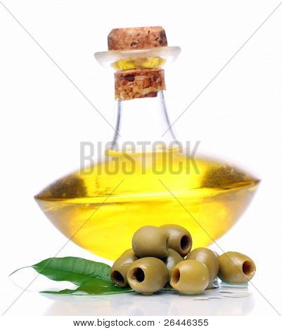 Green olives in oil over white background