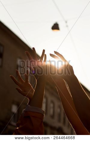 Hands Raised. Nice Silhouette In Shining Sun. Careless Enjoyment In City Walks.