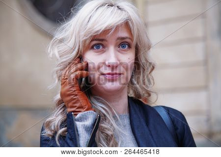 Portrait Of Beautiful Surprised Young Busines Swoman With Smart Phone As Symbol Of Good News