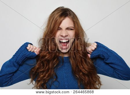 Picture of enraged dissatisfied young female grimacing and making angry gesture. Negative human emotions, feelings and reaction. poster