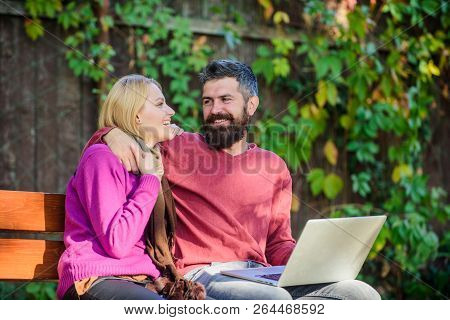 Surfing Internet Together. Couple With Laptop Sit Bench In Park Nature Background. Family Surfing In