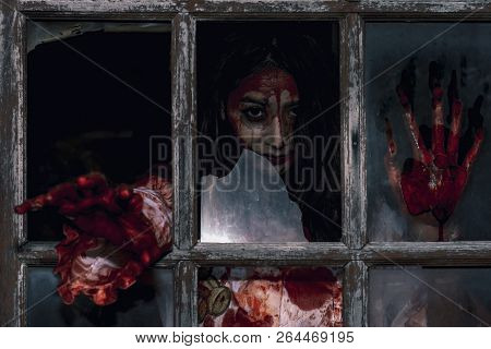 Scary Bloody Zombie Woman In The Hands Hold Ax/knife In The Dark Place; Demon Or Devil Ghost Dangero