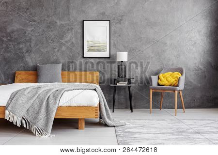 Grey Blanket And Pillow On The Wooden Bed With White Bedding In Stylish Bedroom Interior With Concre