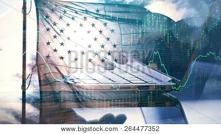 Hand Using Laptop With Forex Chart And American Flag On Sky Background. Economy And Trade Concept. D