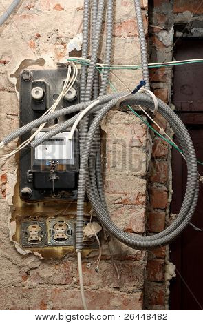 Grungy active energy meter with lots of power cables poster