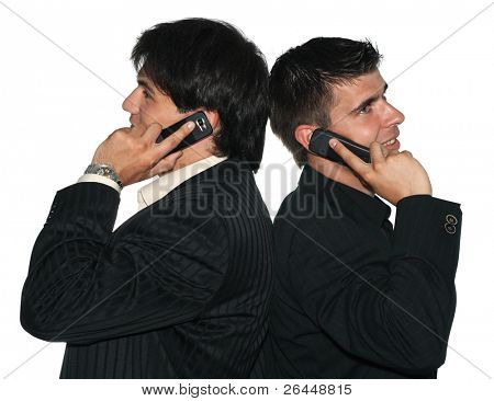 Two young businessmen talking on their mobile phones