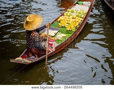 Damnoen Saduak Floating Market, Thailand:- April 12, 2018:- This is a floating Market in Thailand and take a boat then have a great tour at Floating Market Damnoen Saduak, Thailand