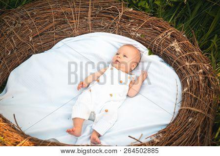 Newborn Baby In Crib. Newborn Baby Awake. Small Girl Or Small Boy On Day Care. Swaddling Helps Baby