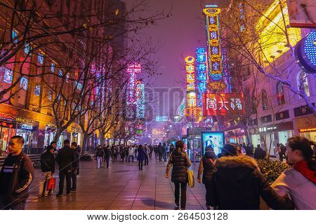 Shanghai/china -  January 24 2015: Night Life Of People Walking In Nanjing Road Walking Street In Sh
