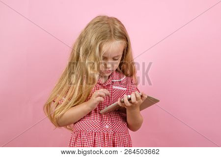 Online Shopping Is A Bad Habit Of Mine. Small Girl In E Shop. Little Girl Shopping On Smartphone. Li