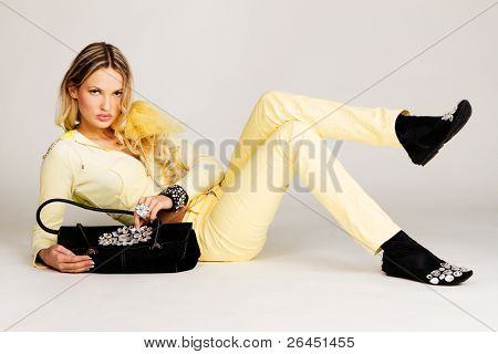 Fashion model in yellow clothing with luxury accessories