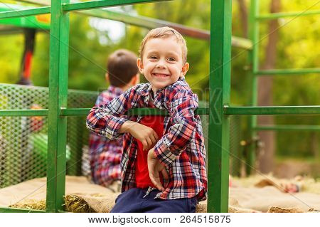 Hayride. Happy Boy Riding A Tractor On A Farm. The Child Having Fun At The Farm