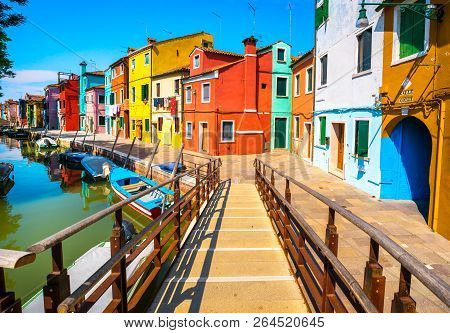 Venice Landmark, Burano Island Canal, Wooden Bridge, Colorful Houses And Boats, Italy, Europe.