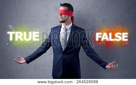 Businessman with red ribbon on his eye deciding true or false poster